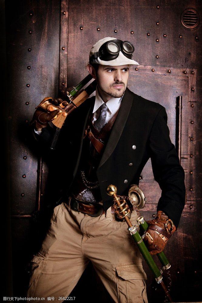 蒸气朋克拿着手枪的男人图片
