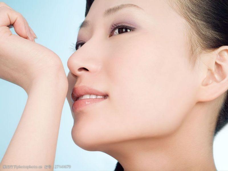 抬手的化妆女人JPG素材图片