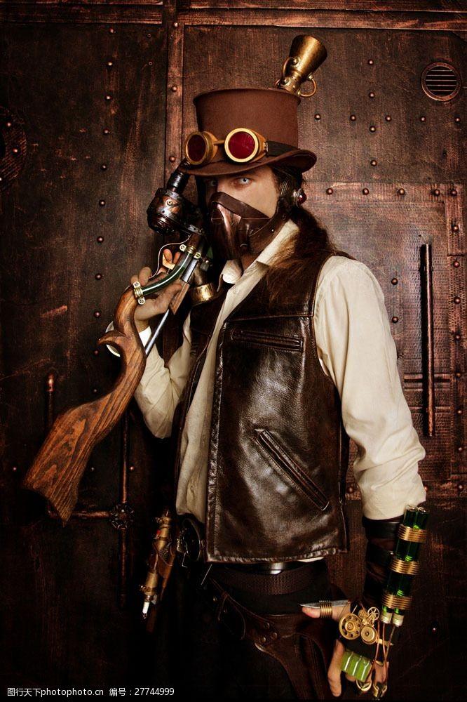 蒸气朋克扛着手枪的男人图片